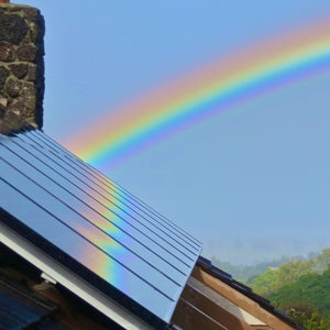 Solar panels reflecting a rainbow